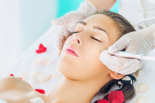 Microdermabrasion is a cosmetic procedure that exfoliates and removes the surface layer of dead skin cells. The procedure is non-invasive, and the tool uses tiny crystals to exfoliate the skin. Some of the systems have suction to vacuum loose skin cells from the face. People who have fine lines, uneven skin tone, hyperpigmentation, and clogged pores will benefit most from the procedure.